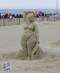 Sexy juicy girl from a sand