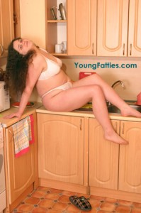 She naked in the kitchen